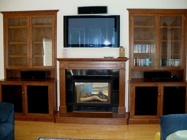 custom display case, fireplace and entertainment center